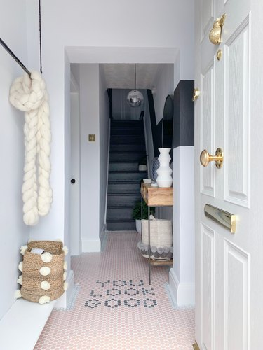 Hallway Makeover Ideas in monochrome hallway with pink and gray penny tiles