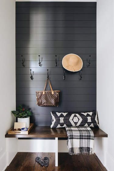 Shiplap hallway accent wall in entryway by Amy Storm & Co.