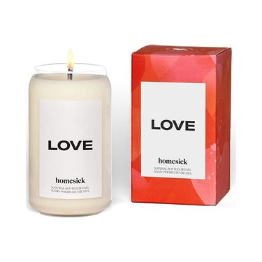 red candle box and off white candle with white label