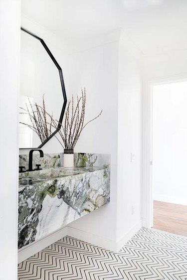 Bathroom Trends 2021 white bathroom with green marble floating vanity