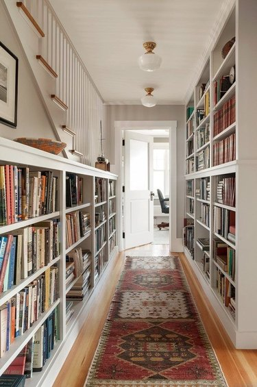 Hallway Focal Point Ideas in cream hallways with bookshelves along wall