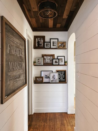Hallway Focal Point Ideas in white paneled hallway with timber ceiling and picture ledges