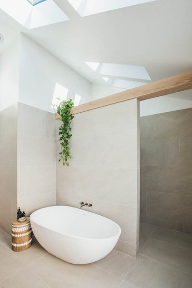 Bathroom Trends 2021 calm spa bathroom with large bath and high ceilings