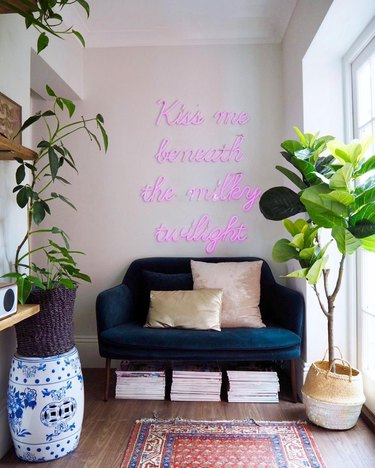 Hallway Focal Point Ideas in eclectic hallway with pink neon sign above velvet sofa