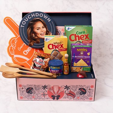 Cravings x Chex Game Day Recipe Kit on whitemarble counter