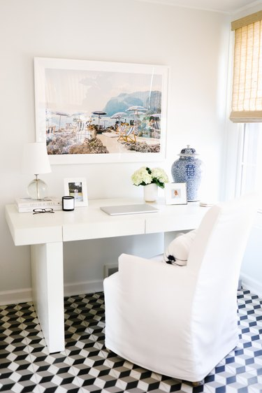 traditional home office with slipcovered chair and oversized photo art