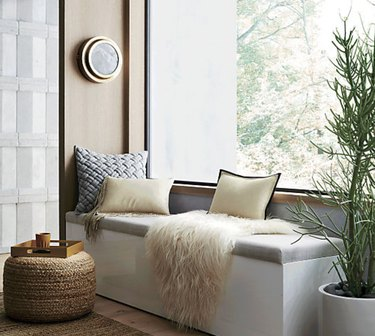 Hallway Benches with cushion and storage, pillows, throw, pouf, tray, plant, window.