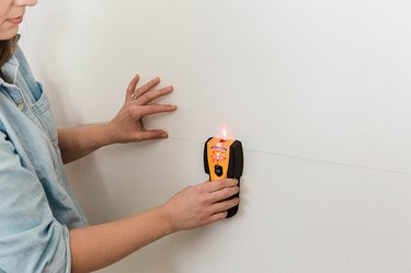 Find the studs using a stud finder.