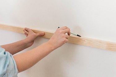 Make a pencil mark along the top edge of the horizontal slat.