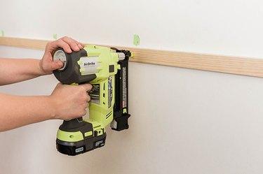 Nail the horizontal slat to the wall.