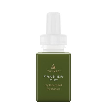 green essential oil bottle with white and gold text