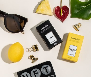 flatlay with essential oil diffuser scents in black and yellow boxes