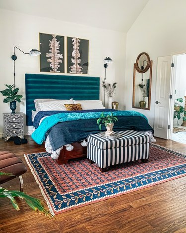 Sarisa Munoz The Indigo Leopard Home bedroom with channel tufted headboard flanked by wall sconces