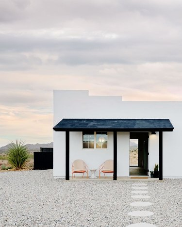 view of a white home in the desert