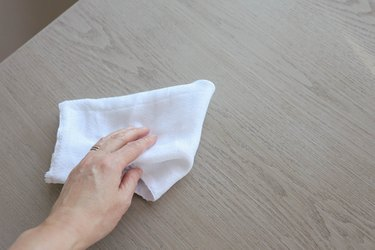 Wiping desk clean with cotton cloth