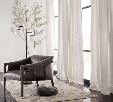 white blackout curtains in bright airy room