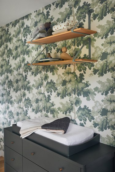 Stuffed Animal Storage in Nursery with hanging shelves and wallpaper designed by Prospect Refuge Studio