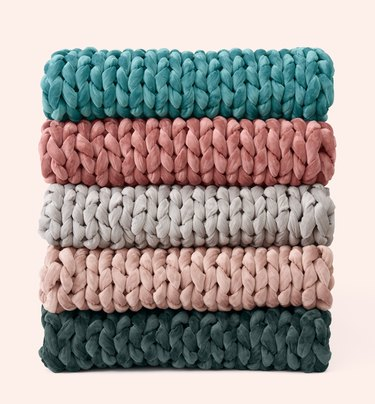 stack of woven blankets