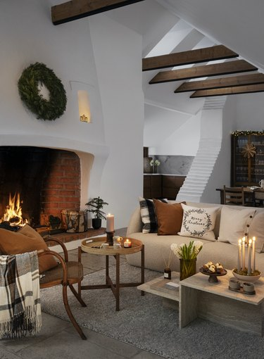 living room with fireplace and holiday decor