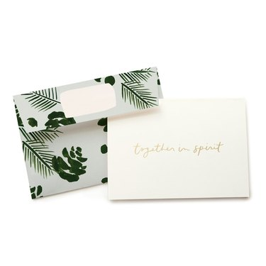 "leaf pattern envelope and greeting card that reads ""together in spirit"""