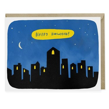 hannukah greeting card with silhouettes of buildings