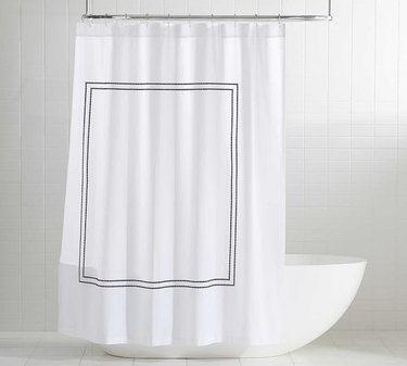 Simple white eco-friendly shower curtain with square design in white bathroom
