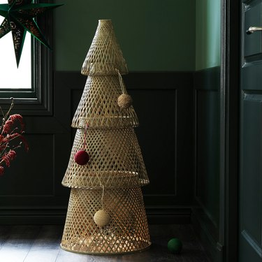 bamboo christmas tree in corner with green walls