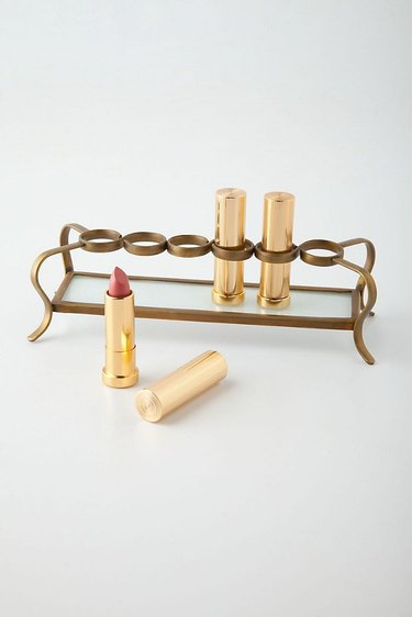 Makeup Organizer Ideas with Brass lipstick holder with glass tray.
