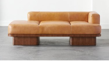 eco-friendly furniture with cognac leather daybed in modern shape on white background