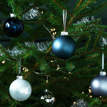 close-up of christmas tree with blue and silver ornaments