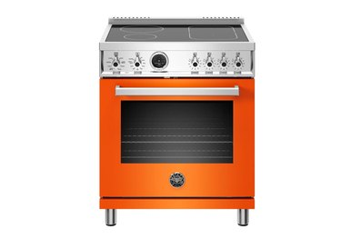 Orange induction stove with stainless steel details and smooth cooktop