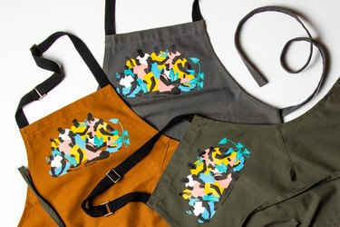 BlueCut + Alex Bowman Plating Change apron in brown, green, and grey
