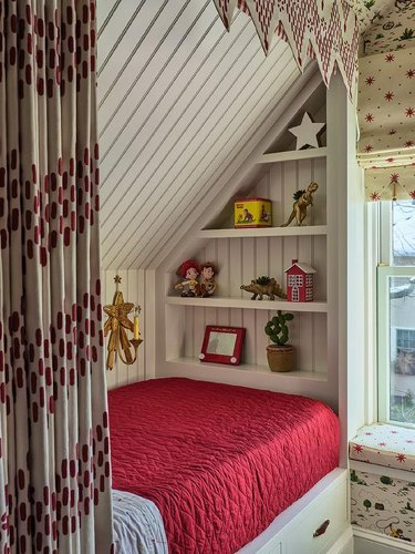 Stuffed Animal Storage with Built-in bed and shelving in a kid's room designed by Cameron Ruppert Interiors