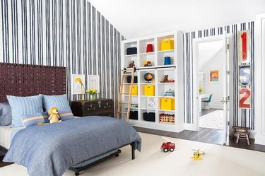 Stuffed Animal Storage in Boy's bedroom with cubbies and organized bins designed by Chango & Co.