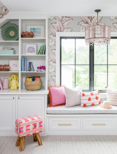 Stuffed Animal Storage in Kid's room with window seat and built-in shelves designed by Stephanie Kraus
