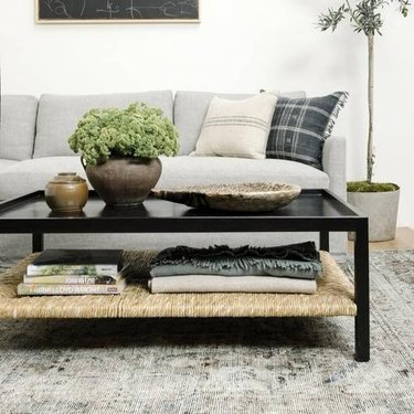 ebonized wood and rushed coffee table with storage
