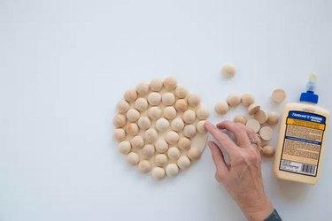 Making trivet using wood beads and glue