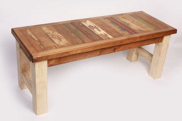 Reclaimed wood from antique doors. The legs are hand distressed in antiqued colors.