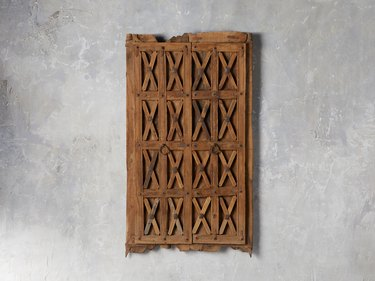 Piece old door with X details and brass circular handles