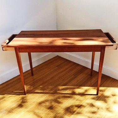 Rectangular table made from a reclaimed carriage house door