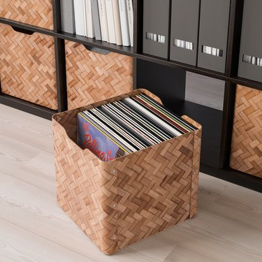 bamboo box with records near storage unit