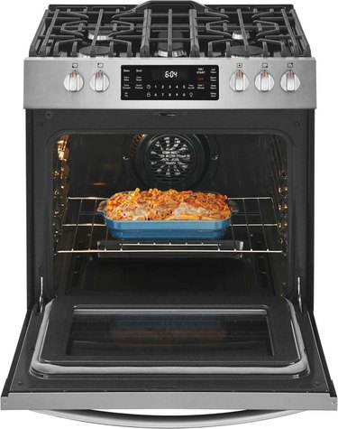 stove brand Frigidaire open stove with mac and cheese inside