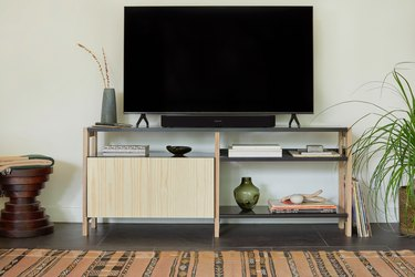 media console with tv near rug