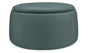 upholstered round teal ottoman/coffee table with storage
