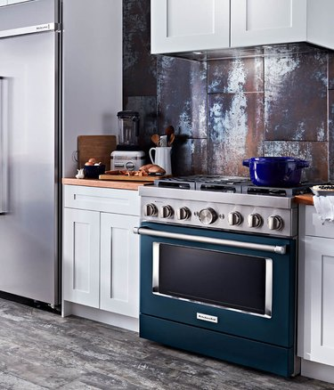 stove brand KitchenAid with teal stove in a gray kitchen