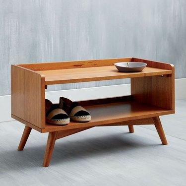Midcentury modern wood shoe organizer.
