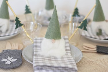 Christmas table decorated with Santa gnomes and mitten utensil holders