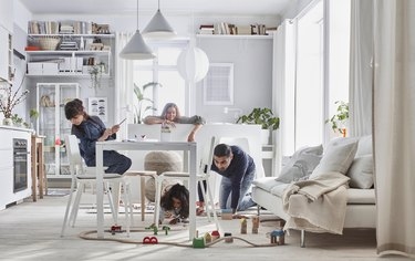 family in living room with table and train