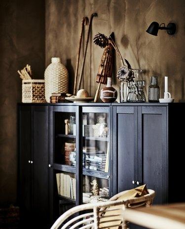 black cabinet near brown walls