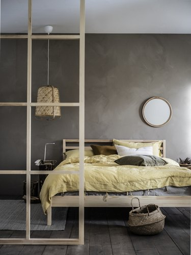 bedroom with gray wall and yellow bedding